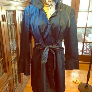 Very stylish blue glossy trench coat